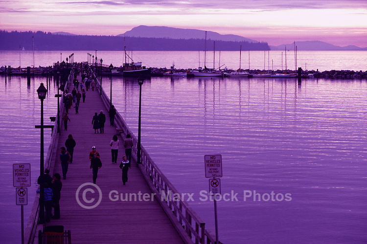 White Rock, BC, British Columbia, Canada - People walking on White Rock Pier along Semiahmoo Bay