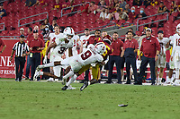 LOS ANGELES, CA - SEPTEMBER 11: Noah Williams #9 of the Stanford Cardinal tackles Tahj Washington #16 of the USC Trojans during a game between University of Southern California and Stanford Football at Los Angeles Memorial Coliseum on September 11, 2021 in Los Angeles, California.