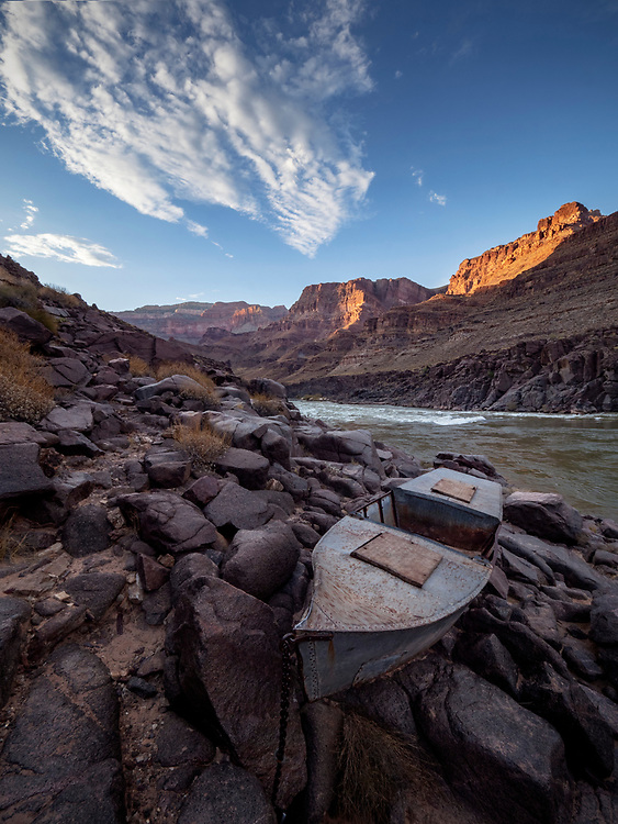 In the early 1900s, Charles S. Russell and river-running legend Bert Loper set out to make a movie about their whitewater adventures on the Colorado River through the Grand Canyon. After the first of their two boats sank in Cataract Canyon, Loper stashed the second boat along the river, hiked out of the canyon, and built a third boat out of galvanized steel. The Ross Wheeler, he called it, named after a local.<br /> <br /> Loper and Russell had a falling out. Russell took the Ross Wheeler and started the trip over with a new crew. The second boat sank. Then a fourth did as well. That was enough for Russell to abandon the third boat, the Ross Wheeler, along the South Bass Trail. Over 100 years later, the boat still rests there, chained to the boulders above the high water mark.
