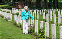 BNPS.co.uk (01202 558833)<br /> Pic: PhilYeomans/BNPS<br /> <br /> Willemein Rieken (84)<br /> <br /> Arnhem 'flower girl' still going strong after 75 As the 75th anniversary of Operation Market Garden begins tomorrow, one of the original 'flower girl''s of Arnhem is still remembering...<br /> <br /> A heartwarming tale of dedication and rememberance has been revealed over a remarkable Dutch pensioner who still tends the grave of a fallen British Arnhem hero, 75 years after he perished in battle.<br /> <br /> Every year, Willemien Rieken (84) still lays flowers at Oosterbeek War Cemetery in memory of Trooper William Edmond, who was shot by a German sniper in the early stages of Operation Market Garden in 1944.<br /> <br /> Trp Edmond, of the elite 1st Airborne Reconnaissance Squadron's final words, uttered to two comrades who came to his aid, were 'tell my wife I love her'.<br /> <br /> Willemien was just nine years old when Oosterbeek became a bloody battleground in September 1944. The retired director's secretary, now aged 84, hid in a small cellar underneath her father's confectionary shop for five days while fierce fighting raged around their house and garden.<br /> <br /> Twenty-five of her family, friends and neighbours packed into the confined space and cowered in fear in the deafening din of shooting and explosions.<br /> <br /> After the war the grateful citizens of Arnhem arranged a poignant ceremony involving a nine year old Willimein and other school children from the town, to lay flowers at the graves of the British soldiers killed in the battle. <br /> <br /> And the dedicated pensioner is now one of the last survivors to still undertake the task.
