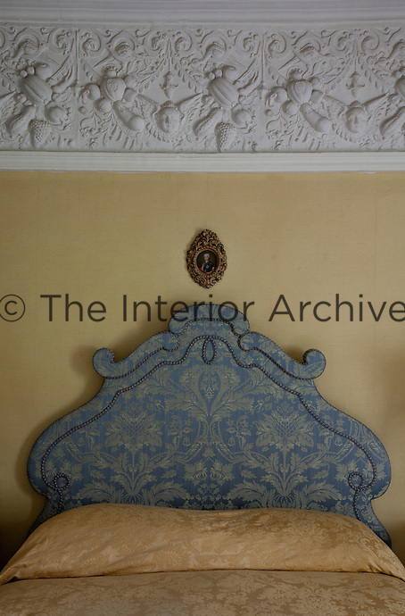 Detail of the damask headboard in the King's Room