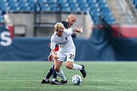 FOXBOROUGH, MA - JULY 25: USL League One (United Soccer League) match. Devin Boyce #20 of Union Omaha and Tiago Mendonca #33 of New England Revolution II tangle at midfield during a game between Union Omaha and New England Revolution II at Gillette Stadium on July 25, 2020 in Foxborough, Massachusetts.
