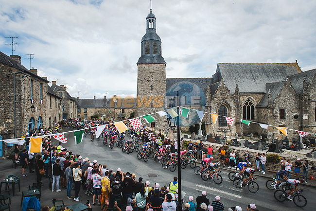 The peloton speed by during Stage 4 of the 2021 Tour de France, running 150.4km from Redon to Fougeres, France. 29th June 2021.  <br /> Picture: A.S.O./Pauline Ballet | Cyclefile<br /> <br /> All photos usage must carry mandatory copyright credit (© Cyclefile | A.S.O./Pauline Ballet)