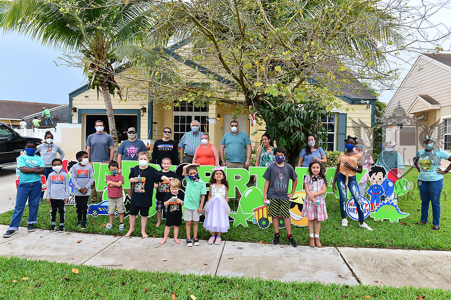 PEMBROKE PINES, FL - April 30: A line of car escorted by City of Miramar and Pembroke Pines Police for Six (6)year old Dylan birthday celebration outside his home with his brothers and parent enjoying a snow corn from a mobile Shave ice van due to the Coronavirus outbreak pandemic on April 30, 2020 in Pembroke Pines, Florida.  ( Photo by Johnny Louis / jlnphotography.com )