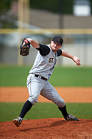 St. Olaf Oles pitcher Nate Marshall (15) delivers a pitch during the first game of a doubleheader against the Union Dutchmen on February 20, 2016 at Lake Myrtle Park in Auburndale, Florida.  Union defeated St. Olaf 7-2.  (Mike Janes/Four Seam Images)