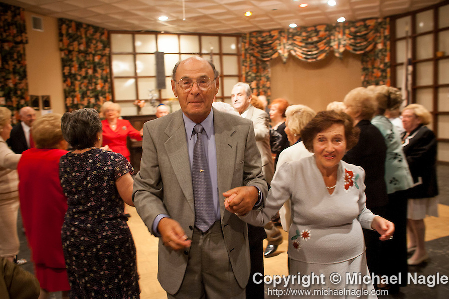 ***© 2005 MICHAEL NAGLE  ALL RIGHTS RESERVED***<br /> <br /> Members of the Four Seasons Lodge Catskills bungalow colony, a summer retreat for Holocaust survivors, attend a party on August 20, 2005.  Photograph by Michael Nagle