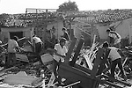 Managua Nicaragua 1973. Families sorting through remains of home after an earthquake.1970s.