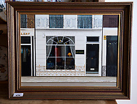 BNPS.co.uk (01202 558833)<br /> Pic: PhilYeomans/BNPS<br /> <br /> No. 99 Motcombe Street, Ian Thomas' shop in London.<br /> <br /> A remarkable 'time warp' Royal archive amassed by the Queen's dressmaker has been found inside his old country home.<br /> <br /> The late Ian Thomas was a dress designer for members of the Royal Family, including Her Majesty, for over 30 years.<br /> <br /> As an apprentice he worked alongside the renowned fashion designer Norman Hartnell on creating the Queen's coronation dress in 1953.<br /> <br /> His archive includes embroidered samples of the gown worn by Elizabeth II for the historic ceremony in Westminster Abbey that was broadcast to millions.<br /> <br /> Mr Thomas also designed outfits for the Queen Mother and Princess Margaret.