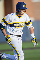 Michigan Wolverines second baseman Hector Gutierrez (24) runs to first base against the Central Michigan Chippewas on March 29, 2016 at Ray Fisher Stadium in Ann Arbor, Michigan. Michigan defeated Central Michigan 9-7. (Andrew Woolley/Four Seam Images)