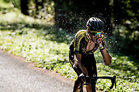 Jack Bauer (NZL/Mitchelton-Scott) coming down the Selle de Fromentel while having refreshed himself (with his bidon) & getting some gel-power in.<br /> <br /> Stage 15 Lyon to Grand Colombier (175km)<br /> <br /> 107th Tour de France 2020 (2.UWT)<br /> (the 'postponed edition' held in september)<br /> <br /> ©kramon