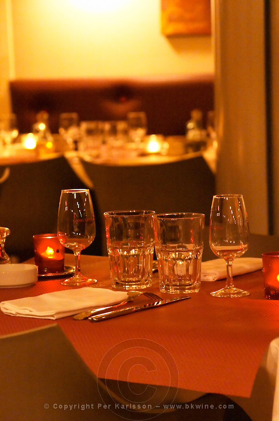 Interior of The restaurant Brunel at night. Tables with glasses, knives, forks, glasses. Candles.  Avignon, Vaucluse, Provence, Alpes Cote d Azur, France, Europe