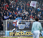 Rangers keeper Liam Kelly tries in vain to clear his goalmouth from streamers thrown from the Rangers support
