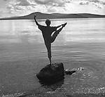 Ballet pose on rock. Moosehead Lake, ME. Cathleen Wild Hurwitz. 1998. Vintage black and white.
