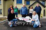 Maurice O'Driscoll presents the key to Marian Murphy Gneeveguilla  who won the Ardfert GAA win a dream house in Killarney draw on Saturday with back row l-r: Carmel Casey, John Lane, Tim Foley, Angela Ryan, Niall Foley