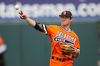 Oklahoma State Cowboys shortstop Donnie Walton #5 throws the ball during the NCAA baseball game against the Texas Longhorns on April 26, 2014 at UFCU Disch–Falk Field in Austin, Texas. The Cowboys defeated the Longhorns 2-1. (Andrew Woolley/Four Seam Images)