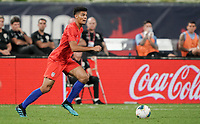 St. Louis, MO - SEPTEMBER 10: Miles Robinson #22 of the United States looks for an open man during their game versus Uruguay at Busch Stadium, on September 10, 2019 in St. Louis, MO.