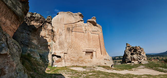 """The Phrygian rock Monument known locally as Yazilikaya, ( written rock ) . 8th - 6th century BC . Midas City, Yazilikaya, Eskisehir, Turkey.<br /> <br /> This is the largest Phrygian rock cut facade monument, measuring 17m x 16.5m. It represents the front of a Phrygian megaron type building with a low pitched roof. It is known locally as yazilikaya , which means """"written rock"""", because of the Paleo-Phrygian inscriptions carved above the rock above the roof outline, down the right side and in the niche. The upper inscription dedicates the monument to King Midas, and so it is also known as the """"Midas Monument"""". The niche probably contained an image of the Phrygian Mother  Goddess, and the word """"Matar"""" (Mother) is inscribed inside. The monument was carved  around the 8th and  6th century BC."""