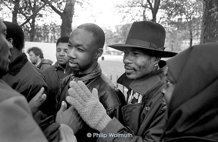 Two men argue with a Christian preacher at Speakers Corner, Hyde Park, London