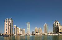 Dubai.  Apartment tower blocks and boats at Dubai Marina...