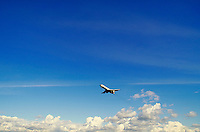 Passenger jet on final approach to Vancouver international airport. Vacation, travel, aviation, plane, aircraft, fly, sky, air traffic control. Vancouver British Columbia Canada, Richmond.