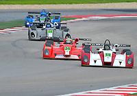 September 20, 2013: <br /> <br /> Jim Booth (M) / Charleston, SC of Performance Tech driving #19 Elan DP-02 IMSA Prototype Lite 1 is followed by Jon Brownson (M) / Breckenridge, CO of Eurosport Racing driving #34 Elan DP-02 IMSA Prototype Lite 1, Don Yount (M) / Dallas, TX of Yount Racing driving #28 Elan DP-02 IMSA Prototype Lite 1 and Mikhail Goikhberg / Vancouver, BC of JDC Motorsports driving #10 Elan DP-02 IMSA Prototype Lite 1 Cooper Tires Prototype Lites Championship Race #1 in Austin, TX.