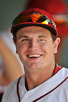 Right fielder Tate Matheny (16) of the Greenville Drive is pictured in the dugout during a game against the Lakewood BlueClaws on Sunday, June 26, 2016, at Fluor Field at the West End in Greenville, South Carolina. Greenville won, 2-1. (Tom Priddy/Four Seam Images)