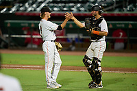 Jupiter Hammerheads pitcher Justin Evans (8) and catcher Cameron Barstad (17) celebrate after closing out a game against the Palm Beach Cardinals on May 11, 2021 at Roger Dean Stadium in Jupiter, Florida.  (Mike Janes/Four Seam Images)