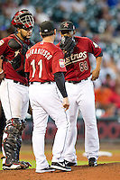 Houston Astros pitcher Wesley Wright #53 talks on the mound with manager Tony DeFrancesco and catcher Carlos Corporan during the Major League baseball game against the Philadelphia Phillies on September 16th, 2012 at Minute Maid Park in Houston, Texas. The Astros defeated the Phillies 7-6. (Andrew Woolley/Four Seam Images).