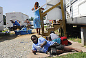 Jamal Griffin, 11 years old,  hangs out at his neighbors' trailer during a school day at Renaissance Village in Baker, Louisiana, May 19, 2006.<br /> (Cheryl Gerber for New York Times)