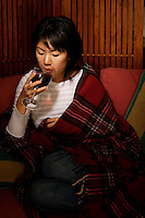 Montreal,  CANADA - Model Released  Illustration Photo - Asian  Girl drinking red wine.<br /> <br /> <br /> Photo :  Agence Quebec Presse - Pierre Roussel
