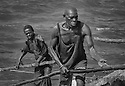 Hard work in the fishing harbour, Stone town Zanzibar