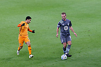 ST PAUL, MN - OCTOBER 18: Chase Gasper #77 of Minnesota United FC passes the ball during a game between Houston Dynamo and Minnesota United FC at Allianz Field on October 18, 2020 in St Paul, Minnesota.