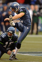 Oct 23, 2005; Seattle, Wash, USA;  Seattle Seahawks punter #16 Tom Rouen holds as kicker #3 Josh Brown kicks the winning field goal with 5 seconds remaining in the game against the Dallas Cowboys at Qwest Field. Mandatory Credit: Photo By Mark J. Rebilas
