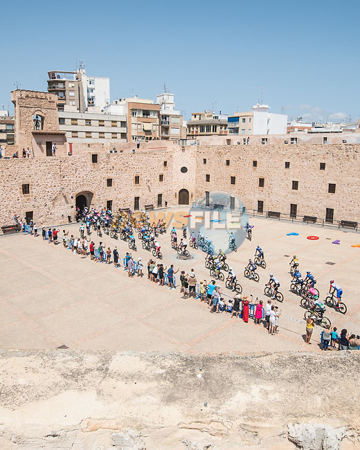 The start of Stage 8 of La Vuelta d'Espana 2021, running 173.7km from Santa Pola to La Manga del Mar Menor, Spain. 21st August 2021.     <br /> Picture: Charly Lopez/Unipublic | Cyclefile<br /> <br /> All photos usage must carry mandatory copyright credit (© Cyclefile | Unipublic/Charly Lopez)