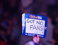 19.12.2014.  London, England.  William Hill PDC World Darts Championship.  Darts fan holds up a 180 at the 2015 William Hill World Darts Championship.