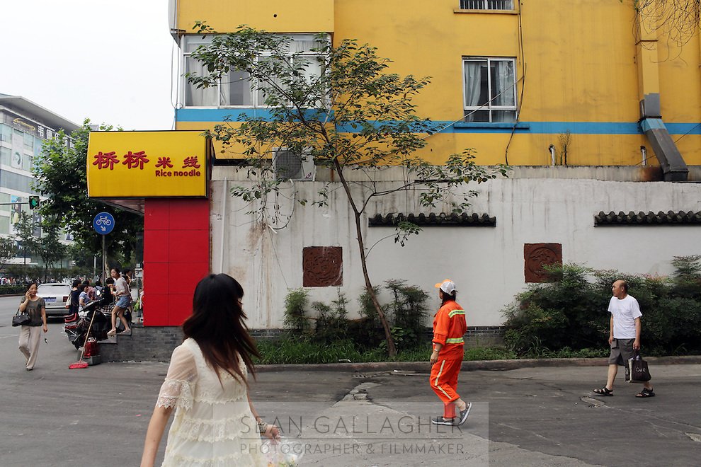 Pedestrians in the city of Chegdu in Sichuan Province, western China.