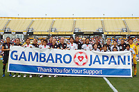 14 MAY 2011: USA and Japan Women's National Team hold a banner supporting the relief effort in Japan before the International Friendly soccer match between Japan WNT vs USA WNT at Crew Stadium in Columbus, Ohio.