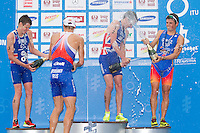 24 JUN 2012 - KITZBUEHEL, AUT - Alistair Brownlee (GBR) of Great Britain (second from right) celebrates winning the men's 2012 World Triathlon Series round in Schwarzsee, Kitzbuehel, Austria with silver medalist Jonathan Brownlee (GBR) (left), series leader Alexander Bryukhankov (RUS) (second from left) and Javier Gomez (ESP) (right) (PHOTO (C) 2012 NIGEL FARROW)