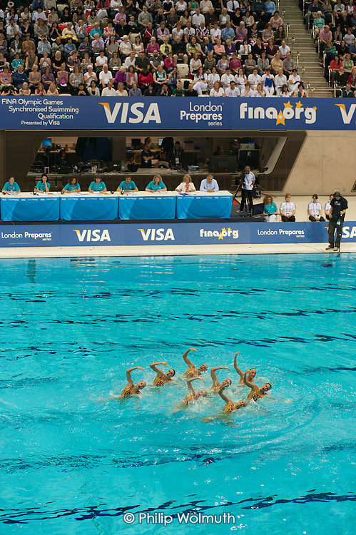 Ukrainian team, Olympic Games Synchronised Swimming Qualification event in the Aquatics Centre, designed by architect Zaha Hadid, Olympic Park, London.