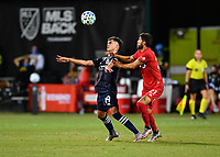 LAKE BUENA VISTA, FL - JULY 26: Jesús Medina of New York City FC takes the ball off his chest while pressured by .tf21 during a game between New York City FC and Toronto FC at ESPN Wide World of Sports on July 26, 2020 in Lake Buena Vista, Florida.