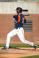 Dan Grovatt #21 of the Virginia Cavaliers follows through on his swing versus the East Carolina Pirates at Clark-LeClair Stadium on February 19, 2010 in Greenville, North Carolina.   Photo by Brian Westerholt / Four Seam Images