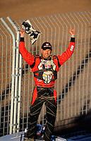 Nov. 6, 2010; Las Vegas, NV USA; LOORRS pro two unlimited driver Carl Renezeder celebrates his victory during round 13 at the Las Vegas Motor Speedway short course. Mandatory Credit: Mark J. Rebilas-US PRESSWIRE