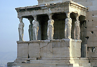 The Porch of the Caryatids, part of the Erechtheion, on the Acropolis. Athens, Greece. Each Kore, or marble carving of an idealized maiden, has individual features, and was made as a memorial, or offering to the gods.