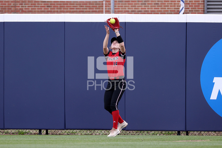 GREENSBORO, NC - MARCH 11: Kira Mickelson #14 of Northern Illinois University makes a catch in the outfield during a game between Northern Illinois and UNC Greensboro at UNCG Softball Stadium on March 11, 2020 in Greensboro, North Carolina.