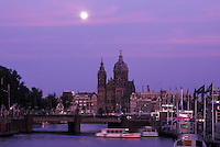 Amsterdam, Holland, Netherlands, Noord-Holland, Europe, Full moon rising over canal in the evening in Amsterdam.