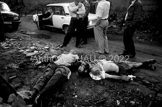 Moscow, Russia .1995.A double homicide discovered by the Mosow police. The bodies were found with bullets and shells scattered about. This is the result of a razbourka gone bad. They were discovered in a garbage dump in an out of the way place.