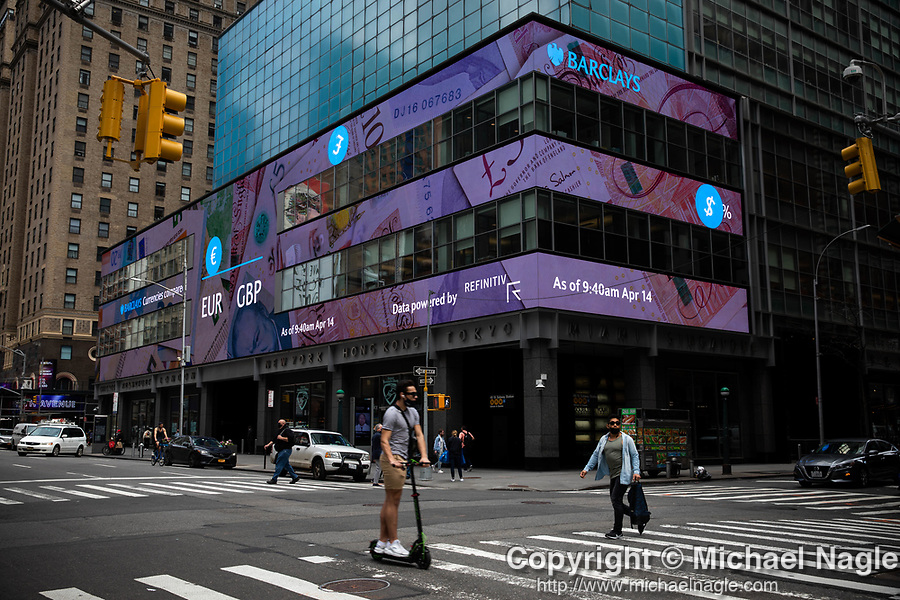 Euro (EUR) and British Pound (GBP) currency information is displayed on monitors in front of Barclay's Investment Bank in New York on Wednesday, April 14, 2021. Photographer: Michael Nagle