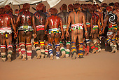 Xingu Indigenous Park, Mato Grosso, Brazil. Aldeia Matipu. Kalapalo warriors in full body paint during the kuarup funeral ceremony.