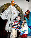 LITCHFIELD, CT. 07  January  2006-010806SV09--Abigail Yanaway, 6, and Henry Yanaway, 3, check out the puppets during a family entertainment day at St Michael's church in Litchfield. The church school used the colossal puppets in a pagent at the church Sunday.<br />  Steven Valenti / Republican-American<br /> (bigail Yanaway, Henry Yanaway, (cq))