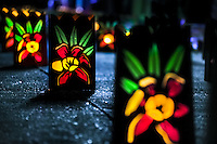 Colorful paper lanterns, depicting flower blossoms, illuminate the street during the annual Festival of Candles and Lanterns in Quimbaya, Colombia, 8 December 2013. A vibrant event, celebrated since 1982 and attracting tens of thousands of visitors every year, is held in honor of the Virgin Mary, on the day of the Catholic Feast of the Immaculate Conception. Each street and neighborhood in the town compete in the contest to create the most spectacular lighting arrangement of their place, employing creatively elaborated lantern designs, which range from religious themes, to symbols of the coffee region or the environmental and wild nature motives. All the streets in Quimbaya center close for one night and some 40,000 lanterns are being lightened up at the festive night.